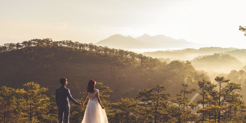 couple-holding-hands-on-hill-wedding-day